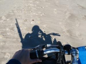 walking w/ my bike. and my guns (aka kayak paddle)
