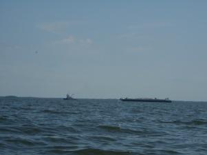 Tug pulling barge