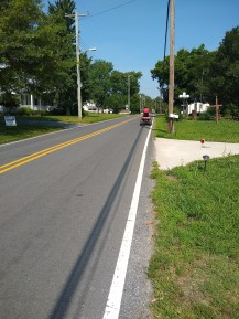cruising main st on a lawn mower